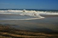 Powerful waves beat against multi-cloured sands in Mazunte