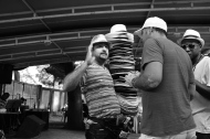 A man selling hats whilst enjoying the samba