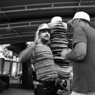 A man selling hats whilst enjoying the samba