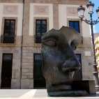 """Per Adriano"" mask sculpture, by Igor Mitoraj in front of the Teatro Guimerá, Plaza de la Isla de la Madeira, Santa Cruz"